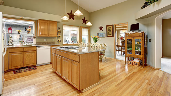 Beautiful kitchen with a hardwood floor that has just been professionally cleaned and sealed.