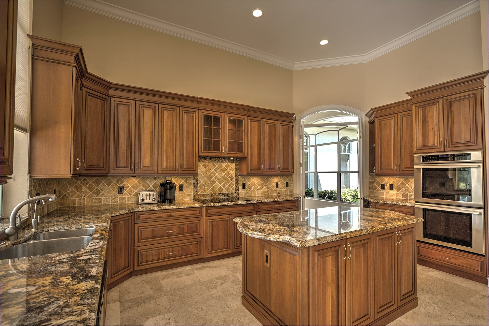 Beautiful kitchen with polished granite countertop and middle island.