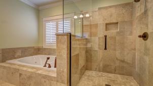 Amazingly restored shower door glass in a combined bathroom.