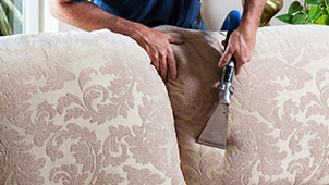 Deep cleaning of an off white upholstered couch removing soil from the fabric.