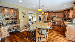 Very spacious kitchen with beige granite countertop